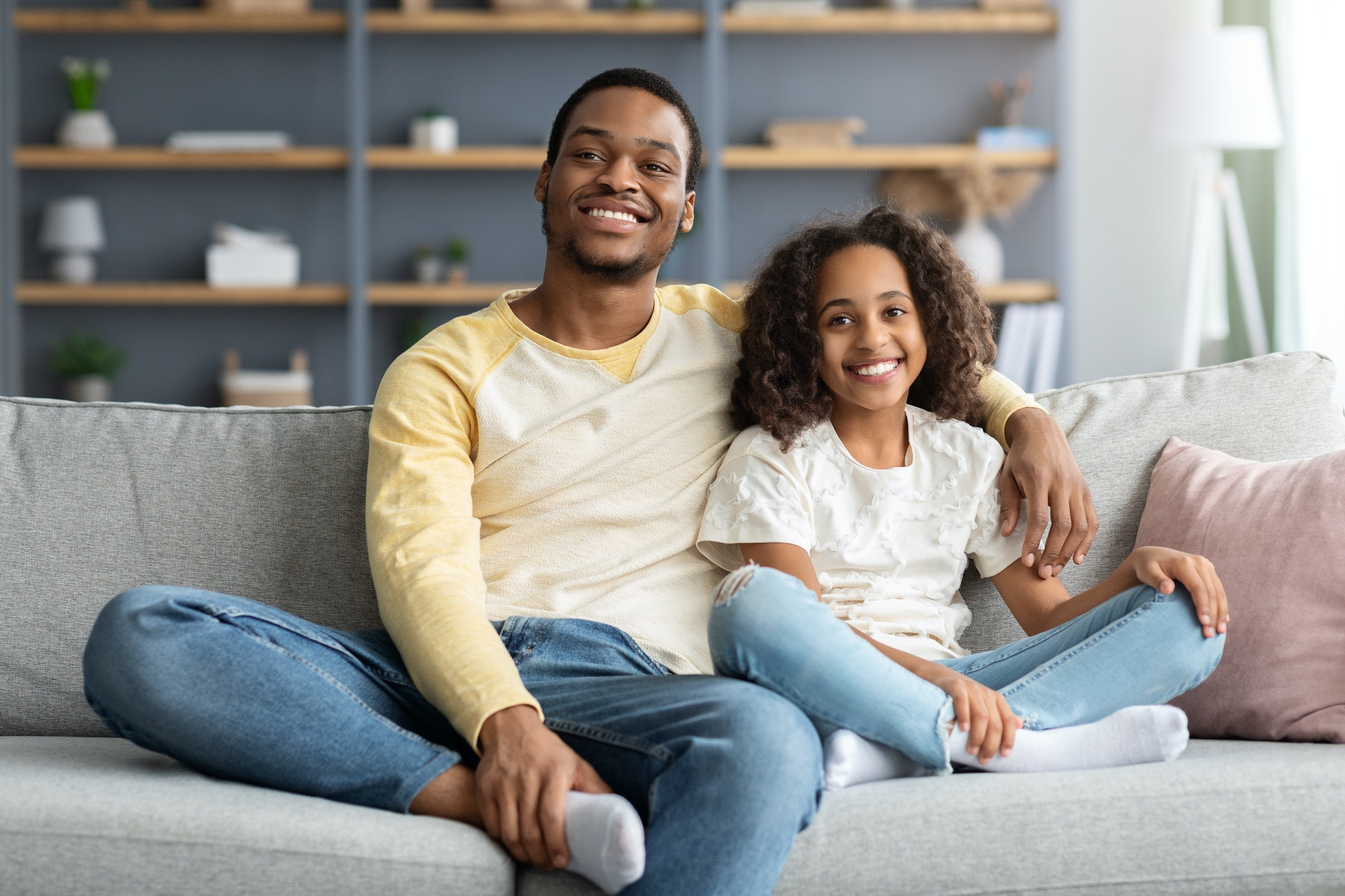 Happy african american family kid and dad spending time together