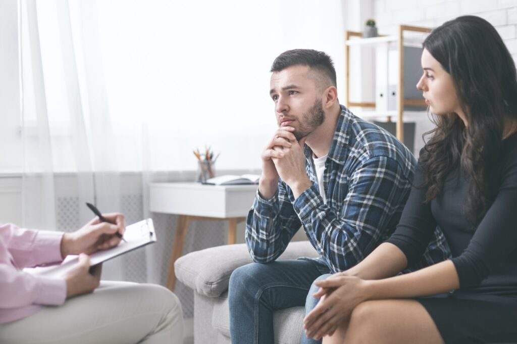 Young grumpy couple at marital counseling therapy